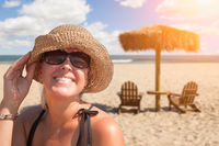 Beautiful Vacationing Woman Relaxing on The Beach