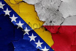 flags of Bosnia and Herzegovina and Poland painted on cracked wall
