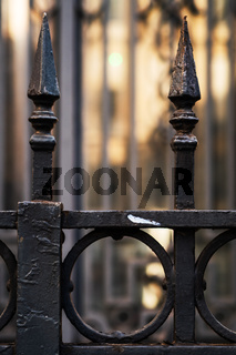 Close-up of a wrought iron entrance gate