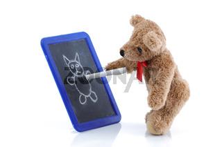 Cute teddy bear drawing on a chalk board