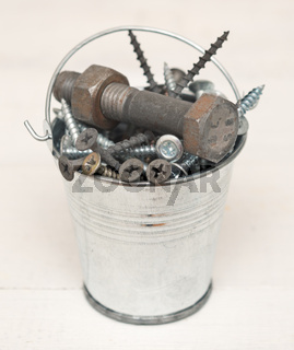 Screws and bolts in a bucket