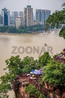 Crowds walking down the plank walk around Giant Buddha