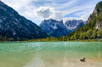 View of a mountain lake with clear water against a background of mountains.