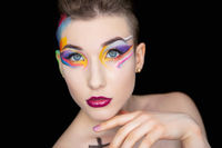 Young attractive brunette with creative make up