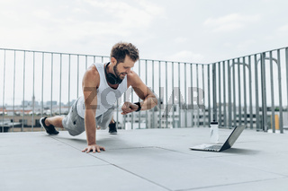 Outdoor health and fitness workout on a rooftop terrace