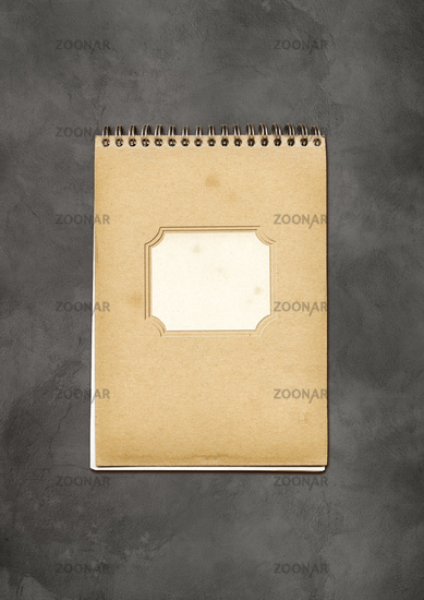 Vintage spiral close notebook on concrete background