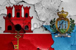 flags of Gibraltar and San Marino painted on cracked wall