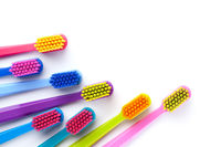 Group Of New Colorful Toothbrushes Isolated