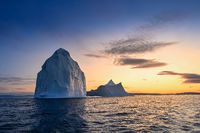 floating glaciers in the rays of the setting sun at polar night