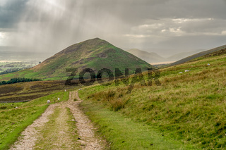 North Pennines landscape with a rain cloud over the Dufton Pike