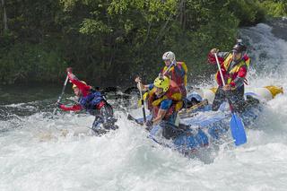 Sports catamaran on the rapids.