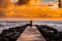 Traveler or man standing on wooden pier at a sunset, epic, wild life