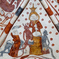 Woman churning Butter with the Devil, and another woman is spanking a devil. Gothic fresco in V. Vem