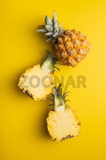 Ripe baby pineapple. Halved mini pineapple.