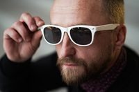 Bearded man portrait. Guy bearded in sunglasses. Close up of handsome bearded man sunglasses