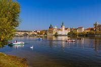 Prague, Czech Republic - October 17, 2017: People boating on the Vltava in center of Prague