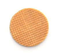 Top view of round freshly baked stroopwafel isolated on white