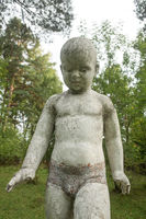 Old sculpture of children In an abandoned pioneer camp