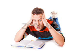 tired college student with book lying on floor preparing studying hard work for exam isolated on white background