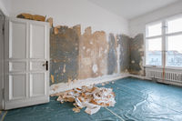 old room during renovation removing wallpaper -