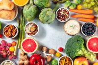 Vegetarian food background with a place for text, a flat lay, shot from the top. Fruit, vegetables and cheese