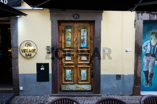 Beautiful painted door on a traditional street in Funchal, Madeira