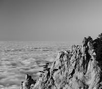 Evening rocks and sea in clouds