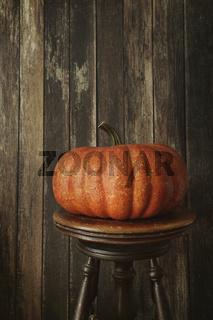 Orange pumpkin against wood background