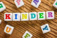 Letter dice on a wooden background - Kids - Kinder German