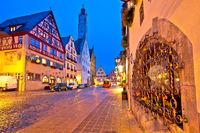 Rothenburg ob der Tauber. German street architecture of medieval German town of Rothenburg ob der Tauber evening view.