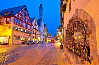 Rothenburg ob der Tauber. German street architecture of medieval German town of Rothenburg ob der Tauber evening view.