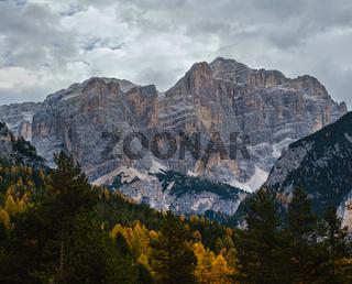 Overcast morning autumn alpine Dolomites mountain scene. Peaceful view near Valparola Path, Belluno, Italy.