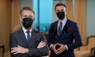 business team wearing crona virus protection face mask