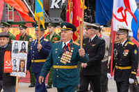 Anapa, Russia - May 9, 2019: A veteran with many orders and medals participates in the victory parade on May 9