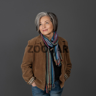 Pretty mid aged grey haired woman in casual portrait. Happy business woman smiling. Human emotions, facial expression concept. Different facial expressions, emotions, feelings