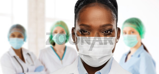 african american doctor in medical mask at clinic