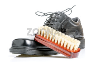 Classic shiny black men's shoe and brush