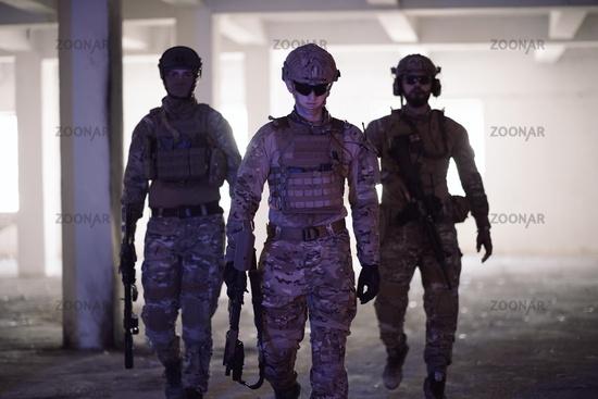 soldier squad team portrait in urban environment colored lightis