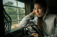 Young female passenger travel by passenger Train