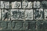 Closeup of carved skulls in a Mayan temple in Chichen Itza, Yucatan, Mexico