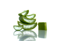 Slices of Aloe Vera leaves on a white background. Aloe Vera is a very useful herbal medicine for skincare and hair care.