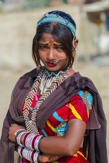 Young indian woman with her piercings and ornaments in Pushkar Camel Fair.