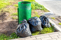 Garbage metal container and plastic garbage bags