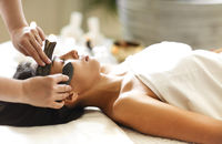 Face massage or beauty treatment in spa salonFace massage or beauty treatment in spa salon