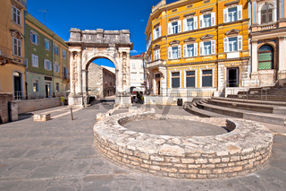 Square in Pula with historic Roman Golden gate street view