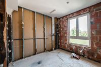 dry wall construction in empty bathroom during home renovation -