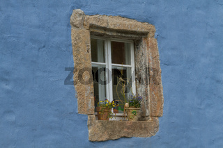 Beautiful ancient window on a blue wall
