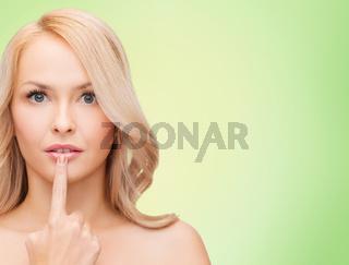 beautiful young woman touching her lips