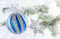 Christmas or winter background with a blue ball.