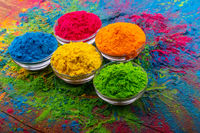 Holi color powder. Organic Gulal colours in bowl for Holi festival, Hindu tradition festive. Bright vibrant pigment closeup